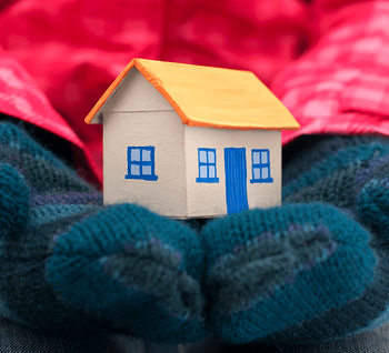 5 Reasons to Buy a New Home in the Winter Gloves Holding Home Image